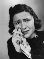 woman-crying-holding-handkerchief-to-her-eyes