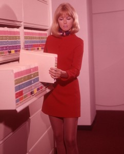 1960s woman red dress at office files
